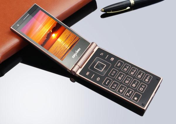 раскладной кнопочный сотовый телефон
